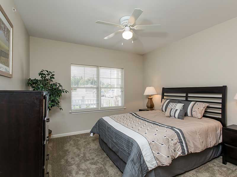 Spacious bedroom of an apartment  at The Legends at Whitney Town Center
