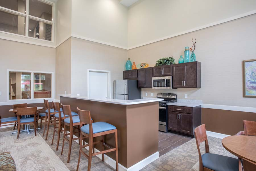Community room kitchen at The Legends at Whitney Town Center