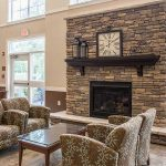 Community room fireplace at The Legends at Whitney Town Center